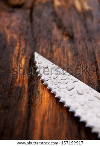 knife. On a wooden board. - stock photo