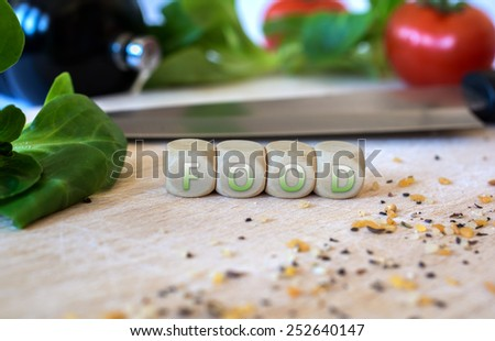 Knife, Salad, Cubes And Spices On A Chopping Board - stock photo