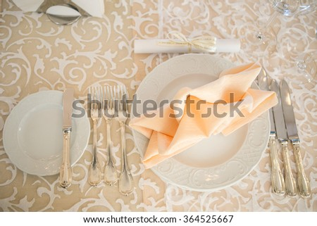 knife with fork and plate. place setting for a dinner at the restaurant. - stock photo