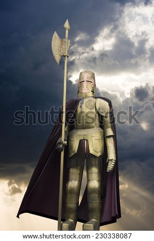 Knight in shining armour with a spear  - stock photo