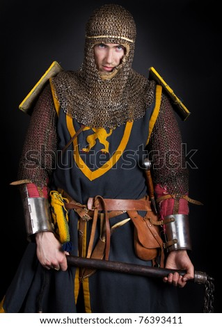 Knight is holding a club - stock photo