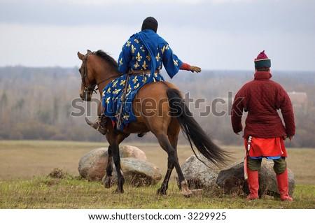 Knight on horse - stock photo