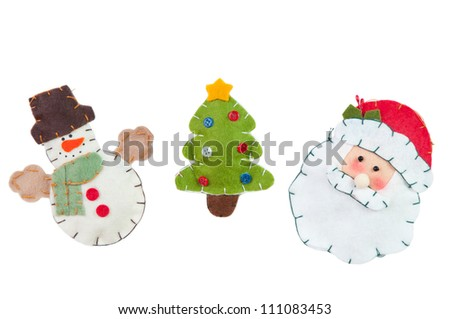 Knitted Christmas decorations: Snowman, green Christmas tree and Santa, isolated on white - stock photo