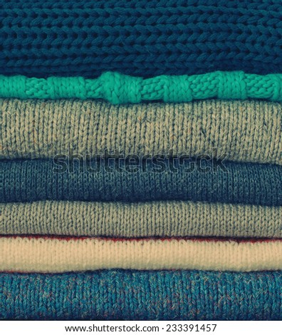 Knitted Color Clothes in stack, vintage style, toned - stock photo