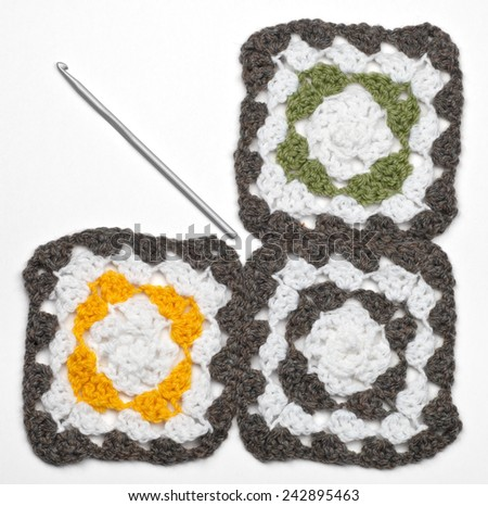 Knitted color pattern and crochet for knitting, isolated on white - stock photo