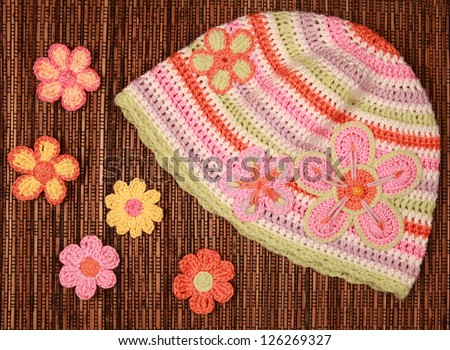 knitted flowers and knitted hat - stock photo