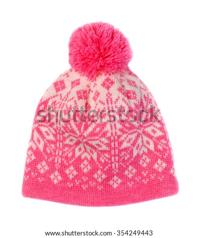 Knitted hat with a pink pattern with a pompon. Isolate on white. - stock photo