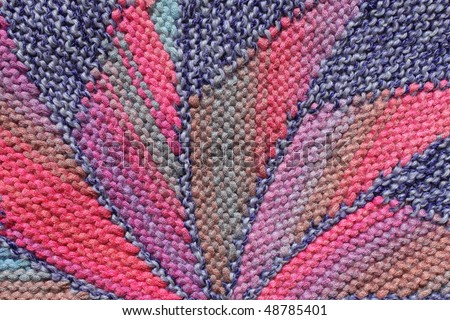 Knitted material as colorful background - stock photo
