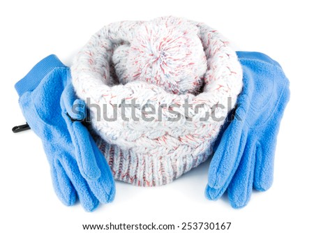 Knitted white hat with blue gloves isolated on white background - stock photo