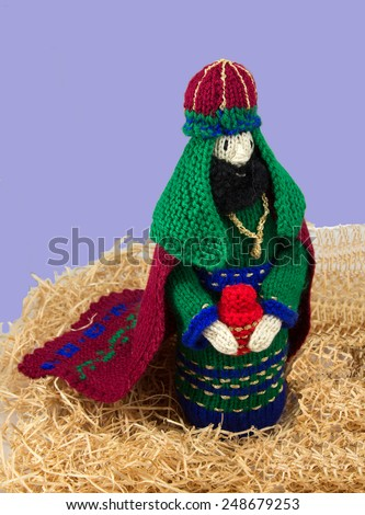 Knitted wise man or king - stock photo