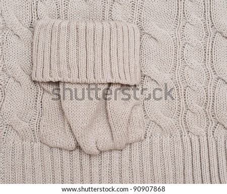 Knitted woolen background with a pocket. Look through my portfolio to find more images of the same series - stock photo