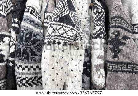 knitted woolen sweaters - stock photo