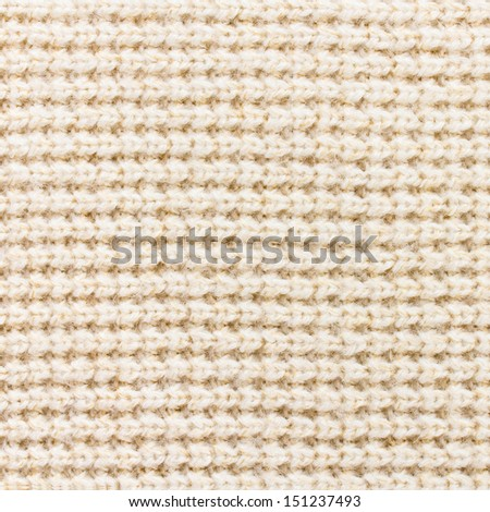 Knitting background texture light beige color.  Fabric textile background - stock photo