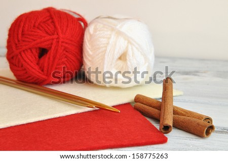 Knitting for Christmas with red and white yarn - stock photo