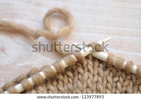 Knitting with brown yarn - stock photo