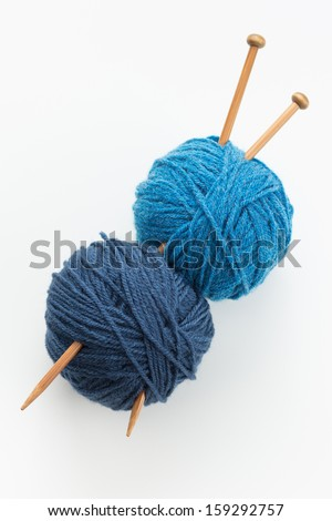 Knitting yarn balls in blue tone and needles - stock photo