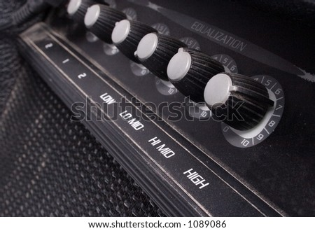 knobs on a guitar amp - stock photo