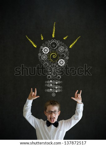 Knowledge rocks boy dressed up as business man with bright idea gear cog lightbulb on blackboard background - stock photo