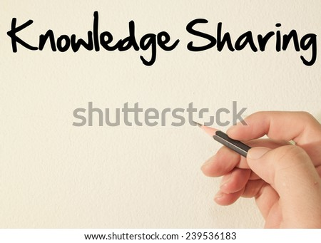 Knowledge sharing  text write on wall  - stock photo