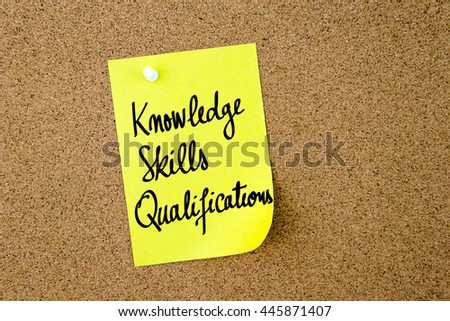 Knowledge Skills Qualifications written on yellow paper note pinned on cork board with white thumbtacks, copy space available - stock photo
