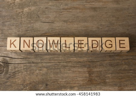 knowledge text on wooden cubes - stock photo