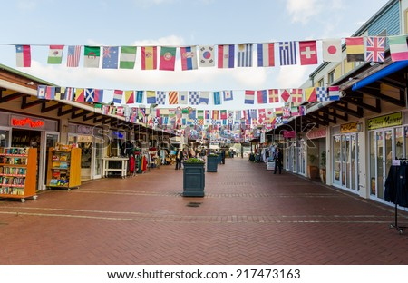 KNSYNA - AUGUST 10: Knsyna Waterfront on August 10, 2014 in Knsyna South Africa. The waterfront of Knysna is a popular tourist attraction with shops and restaurants - stock photo