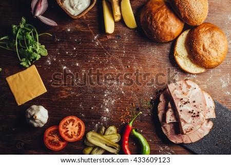 knuckle burger ingredients on a table with space for a logo - stock photo