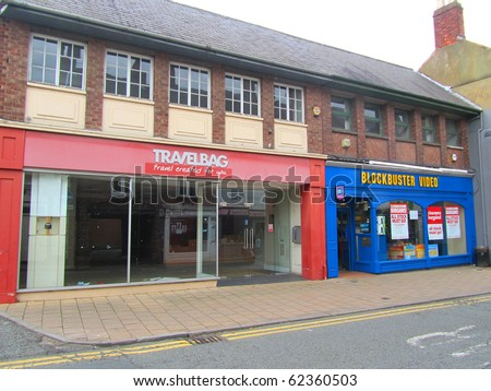 KNUTSFORD, ENGLAND - SEPTEMBER 18: Closing Down at Blockbuster Video and Travelbag September 18, 2010 in Knutsford, England. Photo illustrates recession hitting the UK economy, in this affluent area. - stock photo