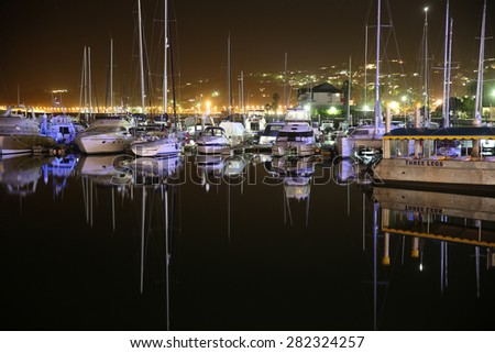 KNYSNA - SOUTH AFRICA - FEBRUARY 17, 2015: The Waterfront of Knysna at the Garden Route by night.  - stock photo