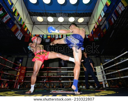KO SAMUI,SURAT THANI - AUGUST 9 : Unidentified players in action at the third anniversary boxing match at Phetchbuncha Thai boxing stadium  on August 9, 2014 in ko samui, Surat Thani, Thailand. - stock photo