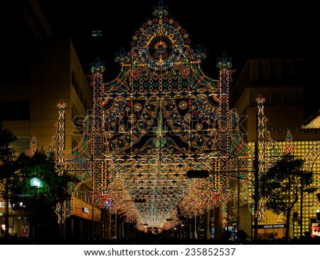 KOBE, JAPAN - DECEMBER 6, 2014: Kobe Luminarie is held annually to commemorate the victims of the Great Hanshin-Awaji Earthquake. Luminarie draws three to five million people each year since 1995.  - stock photo