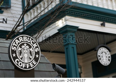 KOBE, JAPAN - JANUARY 5, 2015: Starbucks shop in a colonial-style two story wooden house built in 1907 in Kitano district, Kobe. It is famous for its Western houses from the Meiji and Taisho eras. - stock photo
