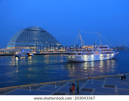 KOBE JAPAN - 2 JUNE, 2014:Unidentified people see off cruise ship at Harborland. Harborland is a shopping district which was made on the site of former freight yard.   - stock photo