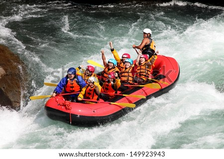KOBOKE, TOKUSIMA JAPAN - AUGUST 11, 2013: White water rafting on the rapids of river Yosino on August 11, 2013 in Koboke Canyon, Japan. Yosino River is one of the most popular among rafters in Japan. - stock photo