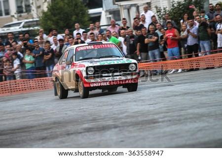 KOCAELI, TURKEY - AUGUST 22, 2015: Engin Kap with Ford Escort MK2 of Bonus Unifree Parkur Racing Team in special stage of Kocaeli Rally 2015 - stock photo