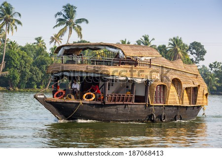 KOCHIN, INDIA-FEBRUARY 23: Indian houseboat on February 23, 2013 in Kochin, India. Houseboat on the river tear city Cochin - stock photo