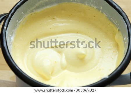 Kogel mogel, cream whipped with eggs and sugar. - stock photo