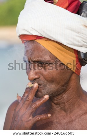 KOGGALA, SRI LANKA - NOVEMBER 9, 2014: Unidentified portrait fisherman in South Sri Lanka - stock photo