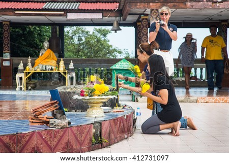 Koh Samui/Thailand - December 17 2013: Buddhism is the biggest religion in Thailand.  Thai belief by offering prayers it can bring wealth and health to them. - stock photo