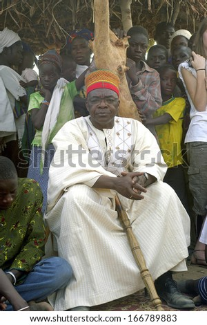 KOKEMNOURE, BURKINA FASO - FEBRUARY 24: Establishment of the new chief of village of Kokemnoure. Andre Silga the new chief hear the history of his line of chief by the griots, february 24, 2007  - stock photo