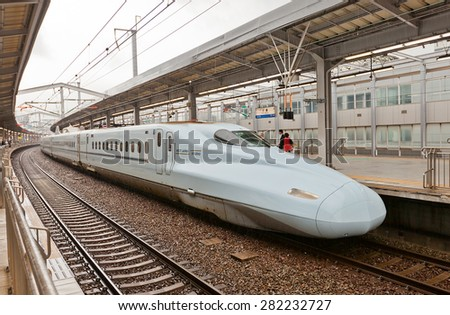 KOKURA, JAPAN - MAY 18, 2015: Japanese Shinkansen high-speed bullet train N700 series of JR Kyushu line on the platform of Kokura railway terminal in Kitakyushu town, Japan. Maximum speed is 300 km/h - stock photo