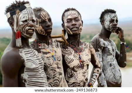 Kolcho, Ethiopia - August, 12: Unidentified Karo boys near the village of Kolcho, Ethiopia on August 12,2014. Karo tribe people are famous for their body painting - stock photo