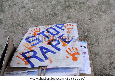 "KOLKATA - DECEMBER 16 : A ""stop rape"" sign lying on the floor after a rally to remember the gang raped victim from New Delhi in the year 2012 - on December 16, 2014 in Kolkata , India. - stock photo"
