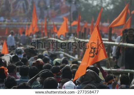 "KOLKATA - DECEMBER 20: ""OM"" signed flags flying high during the Golden Jubilee celebration of Vishwa Hindu Parishad (VHP) - a Hindu nationalist organization on December 20, 2014 in Kolkata,India.  - stock photo"
