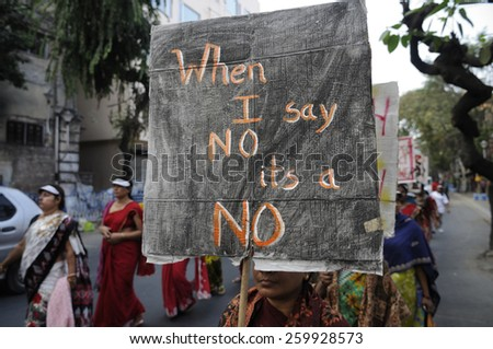 KOLKATA - DECEMBER 16 :Women with a banner emphasizing on women's consent  during a rally to remember the gang raped victim from New Delhi in the year 2012 - on December 16, 2014 in Kolkata , India. - stock photo