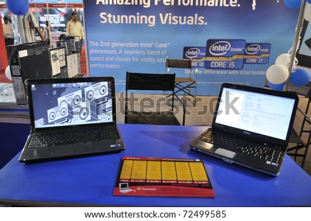 KOLKATA- FEBRUARY 20: Laptops at display at an Intel Processor booth, during the Information and Communication Technology (ICT) conference and exhibition in Kolkata, India on February 20, 2011. - stock photo