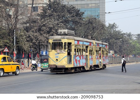 KOLKATA, INDIA - FEB 08: Traditional tram downtown Kolkata on February 08, 2014. Kolkata is the only Indian city with a tram network, which is operated by the Calcutta Tramways Comp. - stock photo