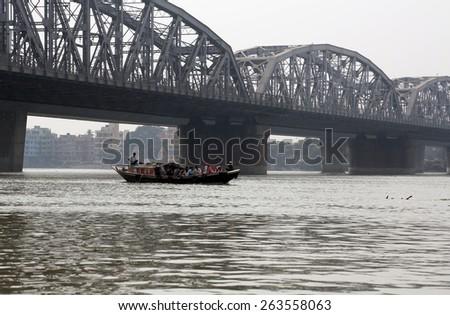 KOLKATA, INDIA - FEBRUARY 2014: Bridge across the river, Vivekananda Setu. It links the city of Howrah, at Bally, to its twin city of Kolkata, at Dakshineswar. - stock photo