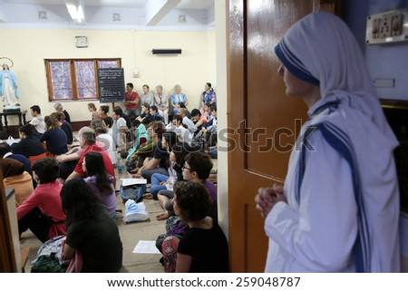KOLKATA, INDIA - FEBRUARY 15: Sisters of Mother Teresa's Missionaries of Charity and volunteers from around the world at the Mass in the chapel of the Mother House, Kolkata, India at February 15, 2014 - stock photo