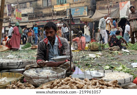 KOLKATA, INDIA - FEBRUARY 11: Street trader sell vegetables outdoor on February 11, 2014 in Kolkata India. Only 0.81% of the Kolkata's workforce employed in the primary sector (agriculture) - stock photo